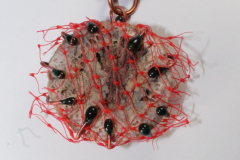 fossilized coral, copper, enamel, textiles